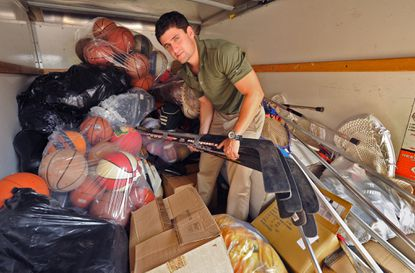 Max Levitt, the founder of Leveling the Playing Field, Inc., a nonprofit organization that collects donations of sports equipment, organizes the sports equipment in his delivery truck before heading to the next donation site, the Boys and Girls Club in Brookyn, on June 9, 2015.