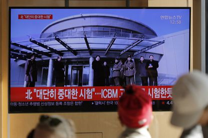 """People watch a TV news program reporting North Korea's announcement with file footage of Kim Jong Un, in Seoul, South Korea on Dec. 8, 2019. North Korea said Sunday it carried out a """"very important test"""" at its long-range rocket launch site that U.S. and South Korean officials said the North had partially dismantled as part of denuclearization steps. The letters read """"North. Very important test."""""""