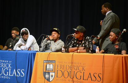 A panel of Baltimore rappers, left to right, Lor Scoota, Young Moose, Chino, and Young Goldie and LIl Key, visit Frederick Douglass High School to share their goals and observations of recent events in West Baltimore after the death of Freddie Gray. The #EYEAMBaltimore Tour High School tour is a partnership between, standing behind them, 7th district Councilman Nick Mosby and Downtown Locker Room.