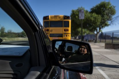 A school bus provides Wi-Fi to those without service on the outskirts of Tuscon, Ariz., April 20, 2020. (Adriana Zehbrauskas/The New York Times)