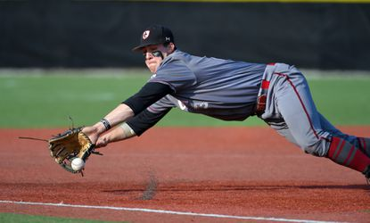 Archbishop Curley third baseman Tyler Locklear makes a diving stop before turning a double play to end the third inning April 11 against Calvert Hall.