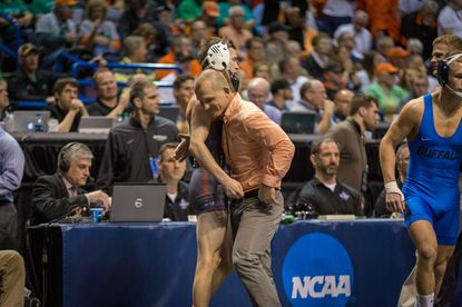 Campbell's Nathan Kraisser, left, and coach Cary Kolat share a hug after Kraisser defeated Freddie Rodriguez of SIU Edwardsville in the blood round of the 2017 NCAA Championships in St. Louis. Kolat, now the head coach at Navy, and Kraisser, who is an assistant at Clarion, will face off as coaches for the first time on Saturday.