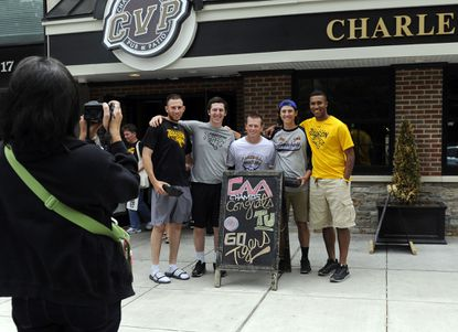 Towson, MD--May 27, 2013--Joanne Beers, left, takes photos of Towson University baseball players outside the Charles Village Pub after they saw their NCAA regional tournament berth announcement on ESPNU Monday. Players, left to right: Mike Volpe, Nick Cioffi, Zach Fisher, Paul Beers, Mike Bronakowski. All are pitchers except Fisher, who plays third base. ( Joanne Beers is Paul Beers' mother.)