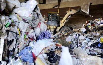 Garbage is stacked into piles before being loaded into a truck in a transfer station at the Northern Landfill in Westminster in this 2015 file photo.