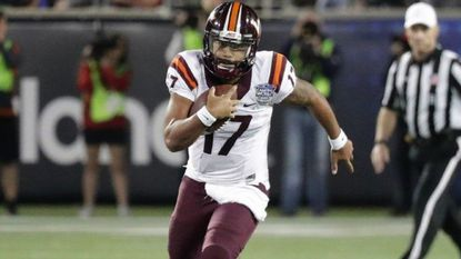 Virginia Tech quarterback Josh Jackson (17) scrambles against Oklahoma State during the second half of the Camping World Bowl, Dec. 28, 2017, in Orlando, Fla.
