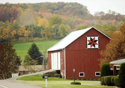 """This is a """"LeMoyne Star"""" quilt pattern is painted on a barn on Garrett Highway in Accident. It's one of the stops along the Barn Quilt Tour, where tourists can view (from their cars) quilt patterns painted on local barns by the Barn Quilt Association of Garrett County."""