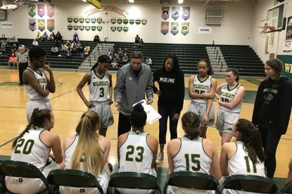 Wilde Lake girls basketball gathers during a timeout in its 37-30 win over Broadneck on Monday, Feb. 3, 2020.