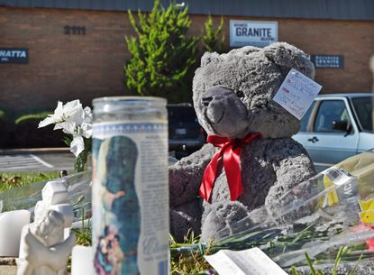 A makeshift memorial at Advanced Granite Solutions for victims of a workplace shooting Wednesday.