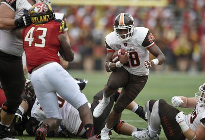 Bowling Green running back Fred Coppet (28) runs the ball against Maryland linebacker Jalen Brooks (43) during the second half of an NCAA college football game, Saturday, Sept. 12, 2015, in College Park, Md. Bowling Green won 48-27.