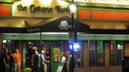 Patrons stand outside The Greene Turtle in Towson Thursday, Sept. 27, 2012.
