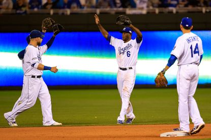 Lorenzo Cain celebrates with Kansas City Royals teammates after defeating the San Francisco Giants 7-2 in Game 2 of the World Series at Kauffman Stadium.