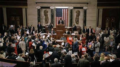 In this image from video, House Speaker Paul Ryan stands at the podium as he brings the House into session thenight of June 22, 2016.