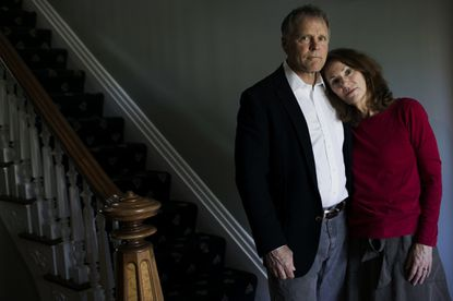 Fred and Cindy Warmbier stand in their home in Wyoming, Ohio, on April 26, 2017. On Thursday, they sued North Korea over the death of their son, Otto Warmbier.
