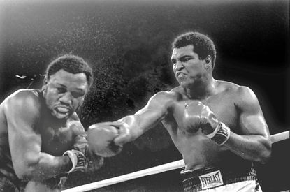In this Oct. 1, 1975 file photo, Heavyweight champion Muhammad Ali connects with a right against challenger Joe Frazier in the ninth round of their title fight in Manila, Philippines. Ali won the fight on a decision to retain the title. Ali, the magnificent heavyweight champion whose fast fists and irrepressible personality transcended sports and captivated the world, has died according to a statement released by his family Friday, June 3, 2016. He was 74. (AP Photo/Mitsunori Chigita)