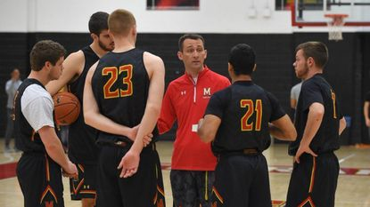 Former Maryland men's basketball assistant coach Dustin Clark directs the scout team during a 2015-16 practice.