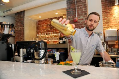 Bar manager Josh Sullivan pours a Cucumberous at Dooby's in Mount Vernon.