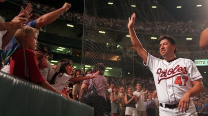 Orioles relief pitcher Jesse Orosco waves to fans Aug. 17, 1999, after breaking the record for career appearances by a pitcher, previously held by Dennis Eckersley.