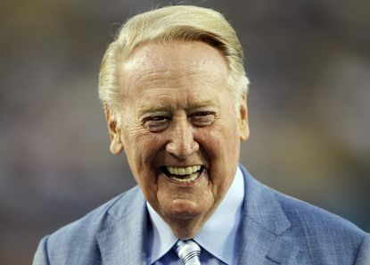 Los Angeles Dodgers broadcaster Vin Scully is honored before a baseball game. Scully was given a Guinness World Records certificate for the longest career as a sports broadcaster for a single team.