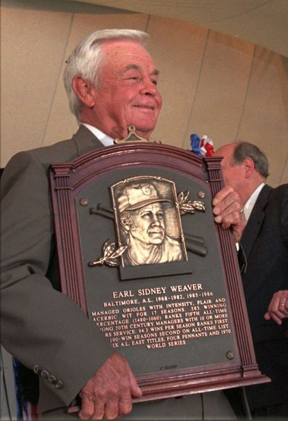 Baltimore Orioles manager Earl Weaver cradles his plaque after ceremonies at the National Baseball Hall Of Fame induction ceremonies Sun., Aug. 4, 1996.