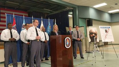 Prince George's Police Chief Hank Stawinski, front left, FBI Special Agent in Charge Jennifer Moore, at lectern, and Officer Joseph Killian, right during during a news conference Thursday on the arrest of Lamont Stephenson.