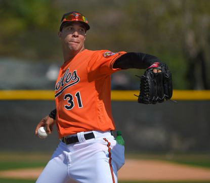 Baltimore Orioles pitcher Ubaldo Jimenez (31) throws off the mound during spring training at the Ed Smith Stadium complex.