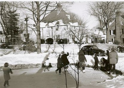"""Skaters enjoy a frozen Homeland Pond around 1960. The image is one of about 150 in the book, """"Dickensian Baltimore: Survivals of a City's Infrastructure Photographed Over 65 Years,"""" a photo collection by former Baltimore County historian and Towson resident John McGrain."""