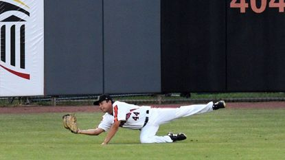 Aberdeen outfielder Nick Horvath makes a diving catch for an out during Wednesday night's game against Lowell at Leidos Field at Ripken Stadium.