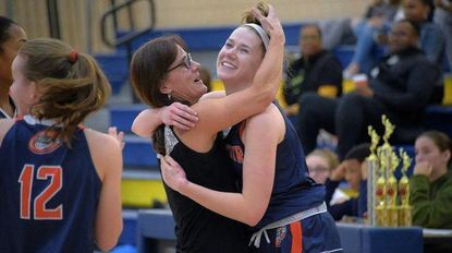 Emily Dorn celebrates her 1,00th point with head coach Deb Taylor.