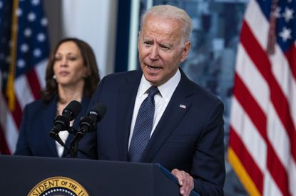 President Joe Biden speaks about the monthly Child Tax Credit relief payments, part of the American Rescue Plan, Thursday, July 15, 2021 in the South Court Auditorium of the Eisenhower Executive Office Building on the White House grounds in Washington, as Vice President Kamala Harris looks on.