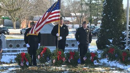 Volunteers placed 750 wreaths on graves of veterans Saturday at Bel Air Memorial Gardens as part of a nationwide observance of Wreaths Across America. An American Legion honor guard stands with wreaths also placed at the Bel Air War Memorial by Town Hall.