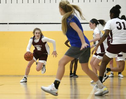 Sophomore Savannah Brooks drives down the court during a practice at Springdale Preparatory School in New Windsor Nov. 14, 2019.