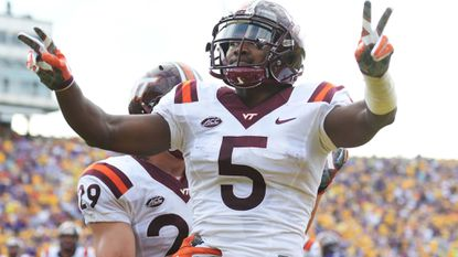 Cam Phillips celebrates after scoring a touchdown for Virginia Tech. Phillips, a former Laurel resident, leads the Hokies in receptions (42), touchdowns (5) and yards gained (608).