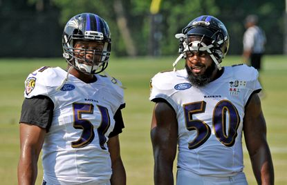 Linebacker Daryl Smith, left, and linebackerAlbert McClellanchat at Ravens practice during training camp on Aug. 17, 2015.