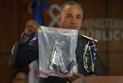 General Ney Aldrin Bautista Almonte, director of the Dominican Republic national police, shows the gun that was used to shoot former Boston Red Sox slugger David Ortiz.