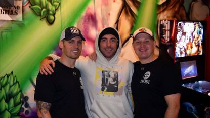 All Time Low singer Alex Gaskarth, center, poses with Full Tilt Brewery founders Dan Baumiller, left, and Nick Fertig in an undated photo.