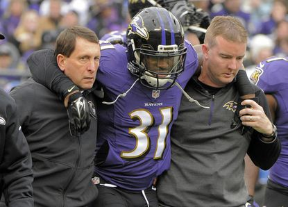 Baltimore Ravens free safety Terrence Brooks (31) has to be helpedoff following an injury against the Jacksonville Jaguars during the first quarter Sunday, Dec 14, 2014.
