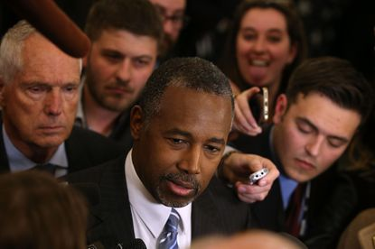 Republican presidential candidate Ben Carson speaks with members of the media in the spin room after the Republican Presidential Debate sponsored by Fox Business and the Wall Street Journal at the Milwaukee Theatre in Milwaukee, Wisconsin.