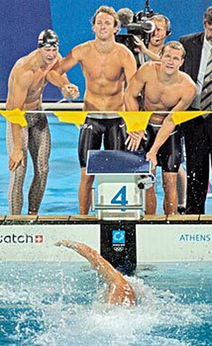 From left, Ian Crocker, Aaron Peirsol and Brendan Hansen clutch hands as Jason Lezak finishes off the United States' world-record-setting effort in the 400-meter medley relay.