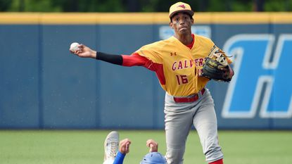 Calvert Hall's Jose Torres throws to first to complete a double play after forcing Loyola Blakefield's Chris MacDonald out at second base in last season's MIAA A Conference championship series.