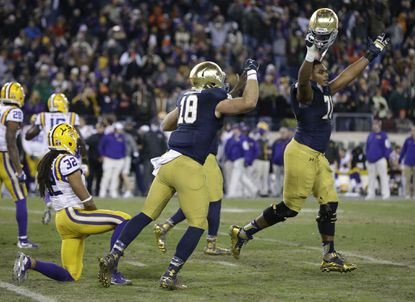Notre Dame offensive lineman Ronnie Stanley, right, and Ben Koyack (18) celebrate after beating LSU, 31-28, in the Music City Bowl onTuesday, Dec. 30, 2014, in Nashville, Tenn.