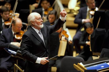 "Composer John Williams leading the Chicago Symphony Orchestra. He'll lead the Baltimore Symphony Orchestra in the ""John Williams Movie Spectacular"" on June 4 to benefit the musicians' pension fund"
