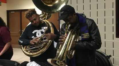 Terrell Tyler on tuba and Randy Hampton on baritone horn warm up before tryouts for the Marching Ravens Saturday at Owings Mills High School. Nearly 200 musicians auditioned for 150 spots.