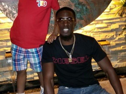 Sherman Reed, 31, with his son. (Family photo)