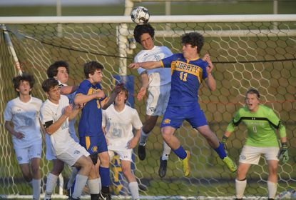 Westminster's Jack Heefner defends the goal with a header as Liberty's Michael Pellicciotti challenges him at the net in the first half. Liberty takes a 4-3, overtime victory to take the Carroll County boys soccer championship Tuesday night in Eldersburg.