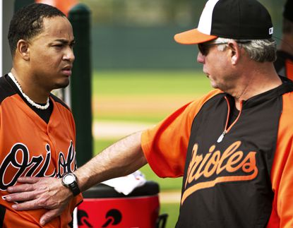 Orioles pitching coach Rick Adair talks with pitcher Jair Jurrjens during spring training in February.