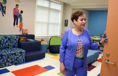 Annette March-Grier, president of Roberta's House, stands in the organization's Cecil & Sheryl Flamer game room, a space for youths at the nonprofit grief support center for children and adults in East Baltimore.