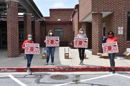 Glenwood High School celebrates the Class of 2020. Lori Jaap, GHS Boosters Club president, Carole Murray, Debbie O'Byrne and Bose Beecroft Abu, GHS PTSA president, get ready to deliver the signs.