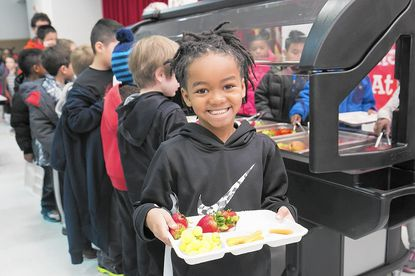 Talbott Springs Elementary School first grader Hassan Tanner makes his first trip to his school's new fruit and salad bar, which opened April 6. Bollman Bridge and Laurel Woods elementary schools will also open up fruit and veggie bars, which are funded by a $200,000 grant from the Horizon Foundation, this month.