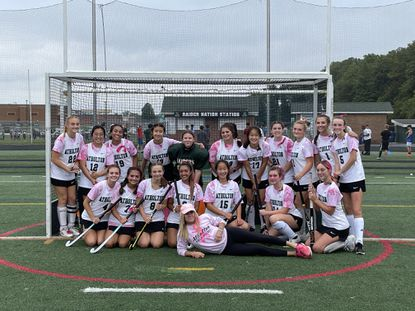 The Atholton field hockey team poses for a photo after its 6-0 win over Hammond on Wednesday, Oct. 6.