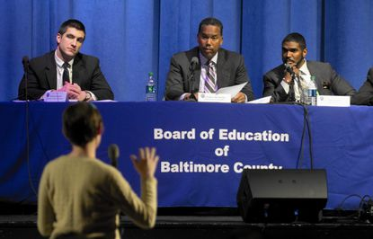 Nicholas Stewart, the board member representing the Catonsville and Arbutus area, listens to Westowne PTA President China Williams speak on Feb. 17 at a public hearing on school redistricting in southwest Baltimore County. To his right are Board of Education chair Charles McDaniels Jr. and Superintendent Dallas Dance.